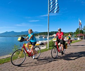 Eurobike cyclists on promenade in Prien at Lake Chiemsee