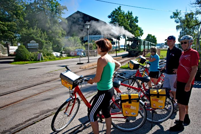 Eurobike cyclists waiting for the steam train in Prien at Lake Chiemsee