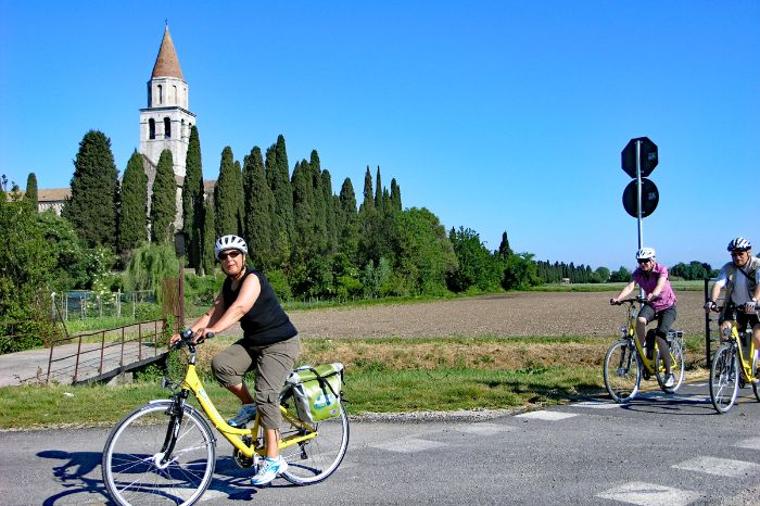 Cyclists in front of church