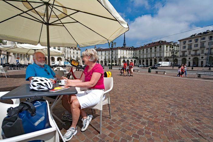 Cyclists having a coffee in the centre of Turin