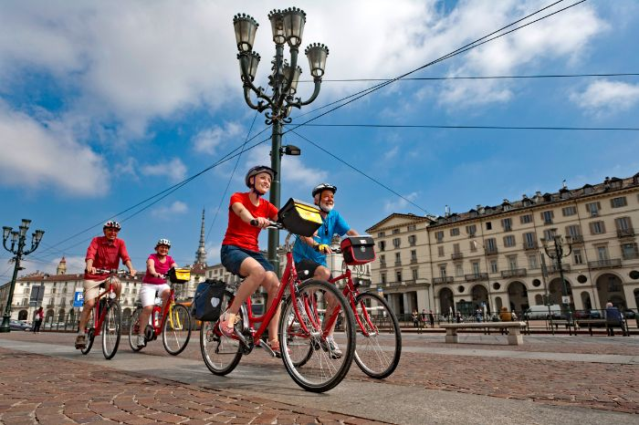 Group of cyclists at the Piazza Vittorio Veneto in Turin