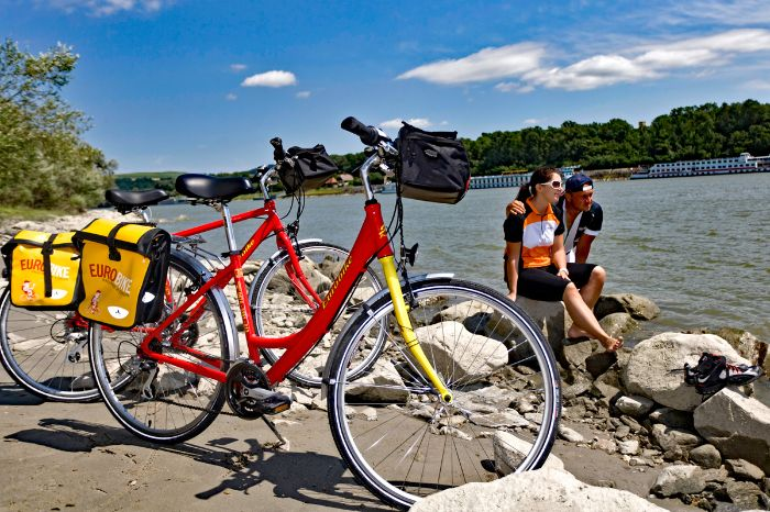 Couple and two bike at the bank of the river Danube