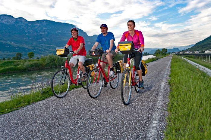 Cyclists on the cycle path along the river Adige
