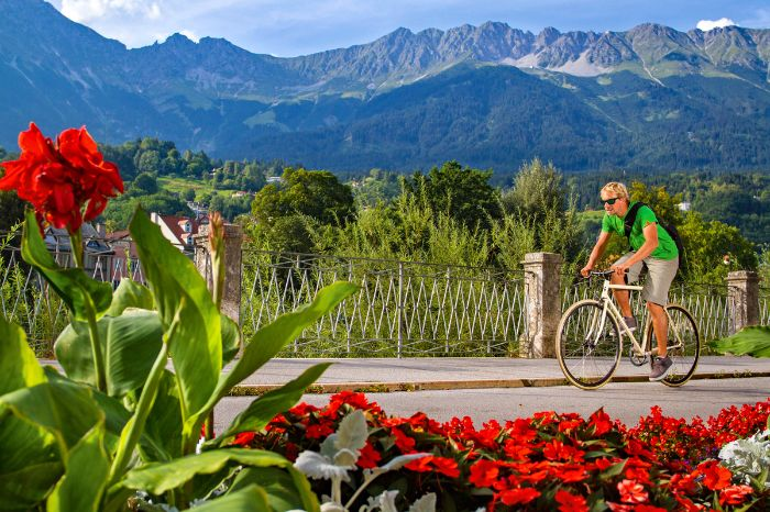 Cyclist in front of panoramic view over the mountains