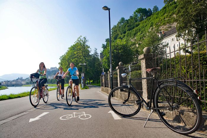Cyclists on cycle path along the river Salzach