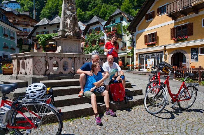 Cyclists having a break in the centre of Hallstatt