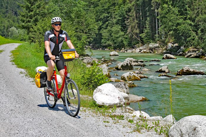 Cyclist at the bank of a river