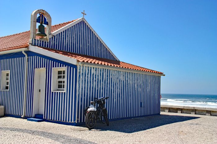 Blue fisherman's chapel at the sea