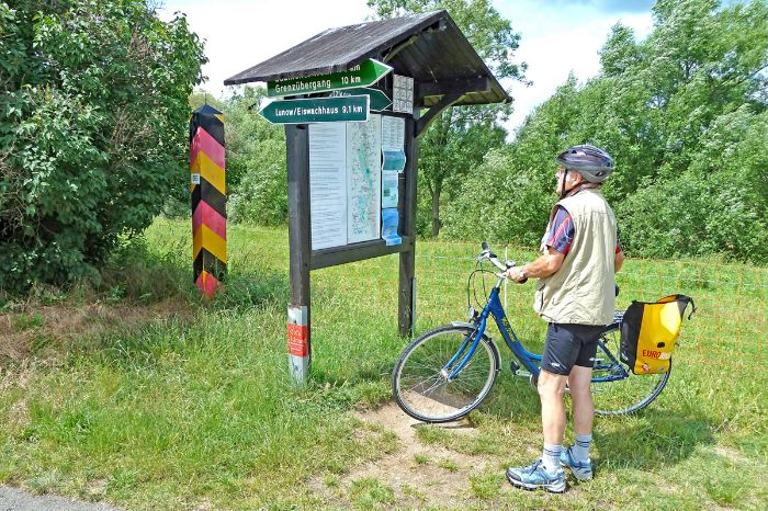 A Cyclist looking at a map