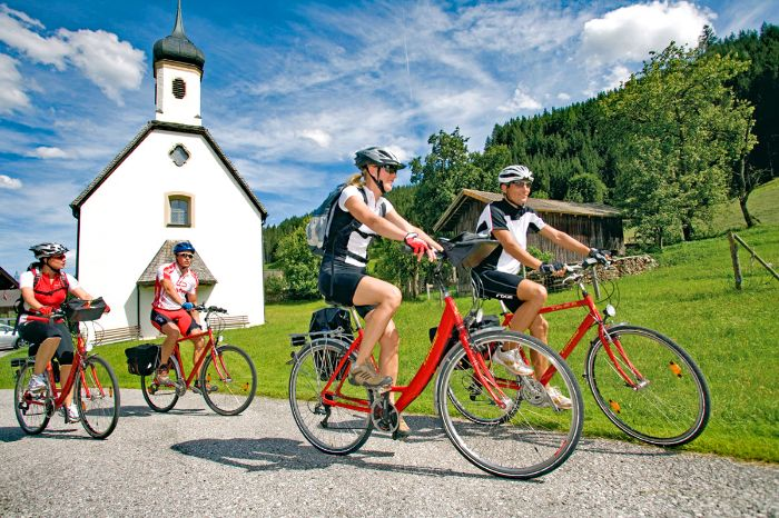 Eurobike cyclists in front of small church in Bad Reichenhall