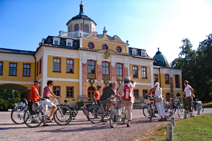 Cyclists in front of castle Belvedere in Dresden