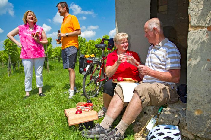 Cyclists having a break with a glass of wine