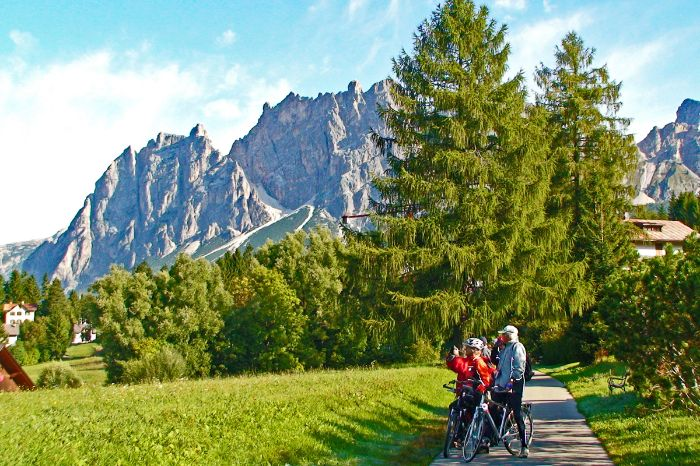 Cyclists in front of the Dolomites