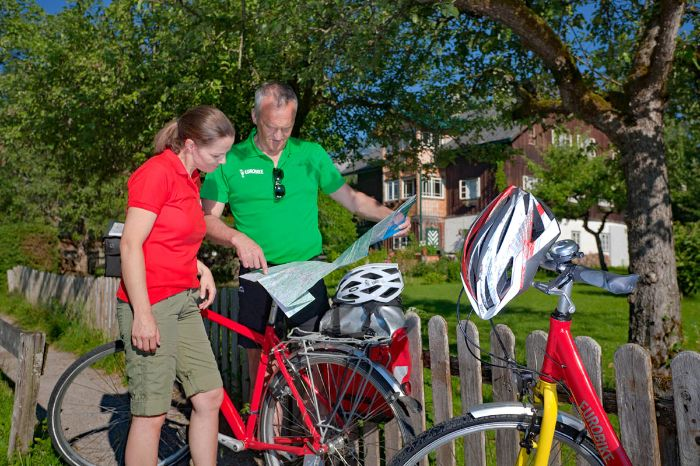 Cyclists take a look at a map
