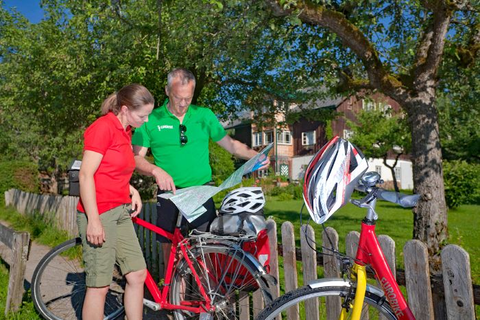 Cyclists having a look in a map