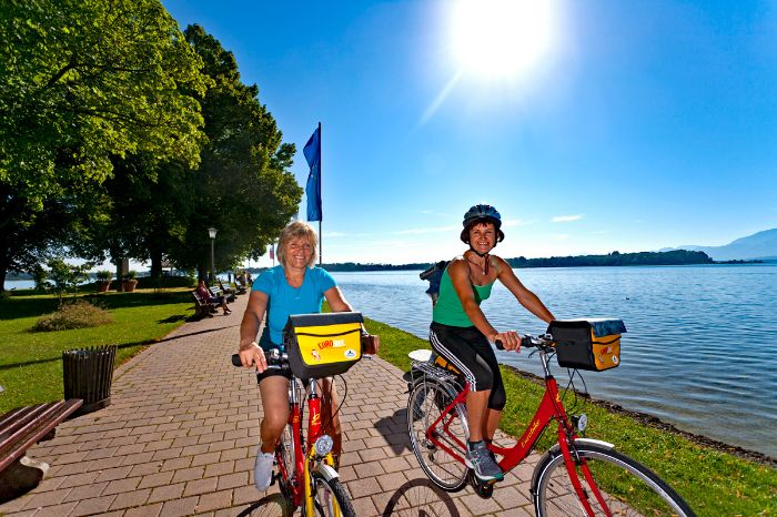 Cyclists at the sunny bank of Lake Chiemsee