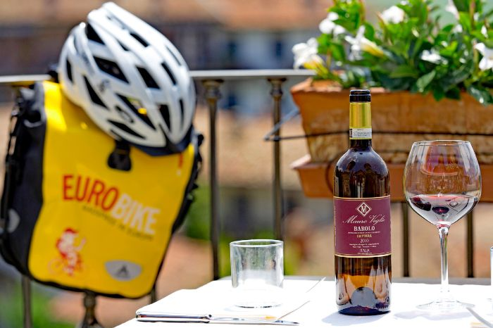 Eurobike panier and helmet next to a table with wine