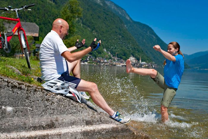 Cyclists splashing around at Lake Hallstatt