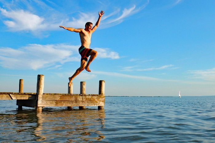 Man jumps in the Lake Neusiedl