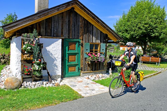 Cyclist in front of wooden cot