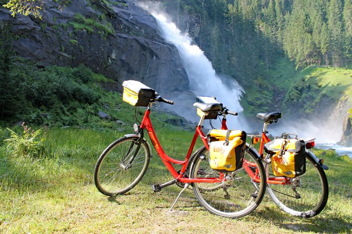 Two Eurobike-bikes in front of the waterfalls of Krimml