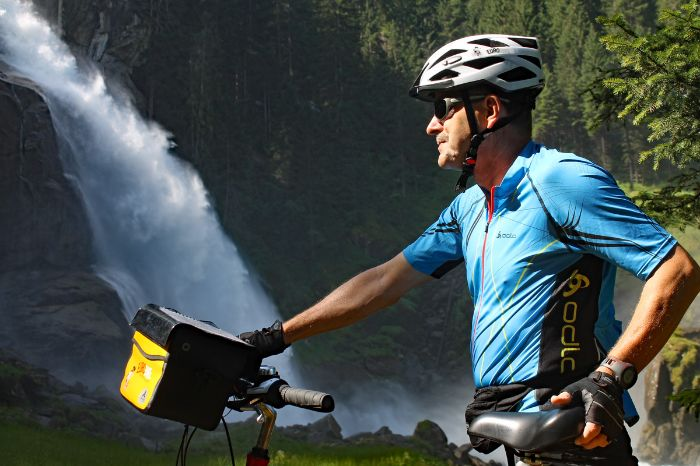 Cyclist in front of waterfall